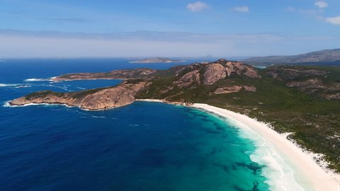 Aerial view of picturesque coastline of Hellfire Bay, colorful cliffs and rocks protruding above crystal clear waters of Southern Ocean - Cape Le Grand, Esperance, Western Australia from above, 4k UHD