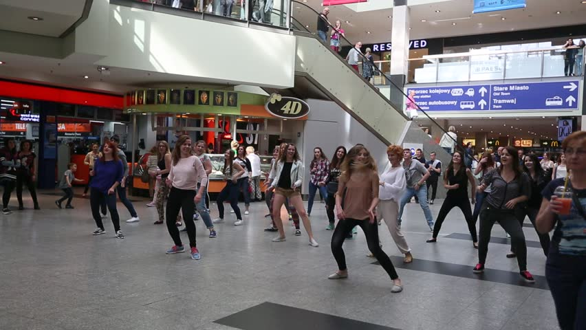 KRAKOW, POLAND - MAY 16, 2015: Unidentified participants in a dance flash mob at the Central city train station.