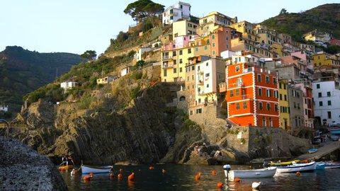Riomaggiore, Cinque Terre, Italy beach and dock. Riomaggiore is a traditional fishing village in La Spezia, situate in coastline of Liguria of Italy. Riomaggiore is one of Cinque Terre travel village.