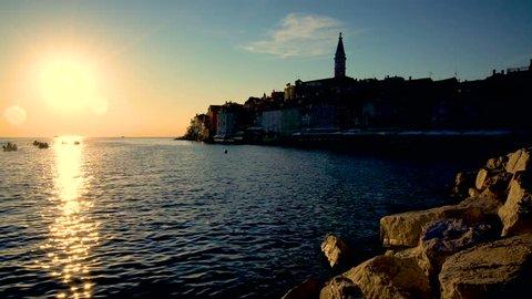 Sunset at Rovinj, Croatia - Panoramic view of old town of Rovinj in Istria, Croatia at beautiful sunset sky. Rovinj is a popular tourist resort, active fishing port and culture travel of Croatia.