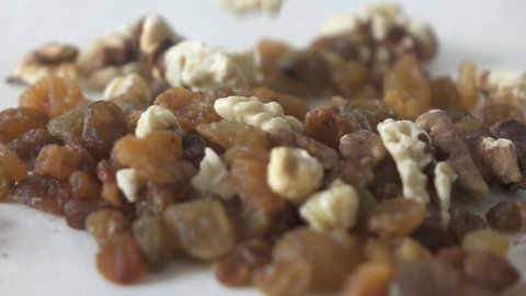falling raisins and walnuts in slow motion
