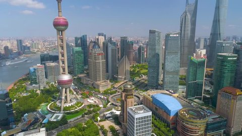 SHANGHAI, CHINA - MAY 5, 2017: Aerial view video, business finance centre skyscrapers skyline, Huangpu river with bridge, historical and modern architecture, Bund, Pudong