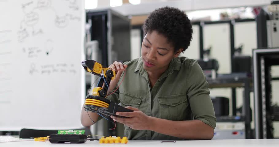 Female working on robotics | Shutterstock HD Video #1008340927