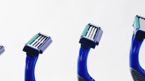 Disposable blue razors closeup. Smooth rotation.