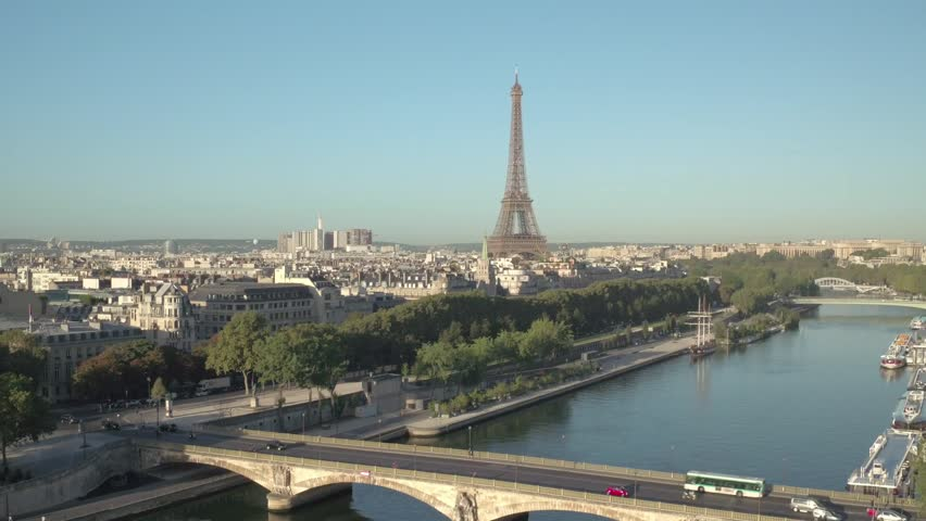Eiffel Tour aerial view over Seine river with Parisian bridge | Shutterstock HD Video #1008361267