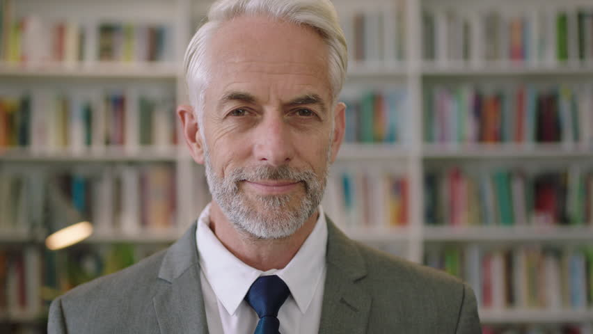 Portrait of professional businessman in library smiling gentleman architect professor lecturer | Shutterstock HD Video #1008367477