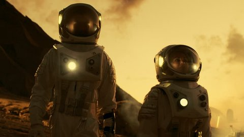 Two Astronauts Talking while Exploring Mars/ Red Planet. Space Exploration, Adventure and Colonisation Theme. Shot on RED EPIC-W 8K Helium Cinema Camera.