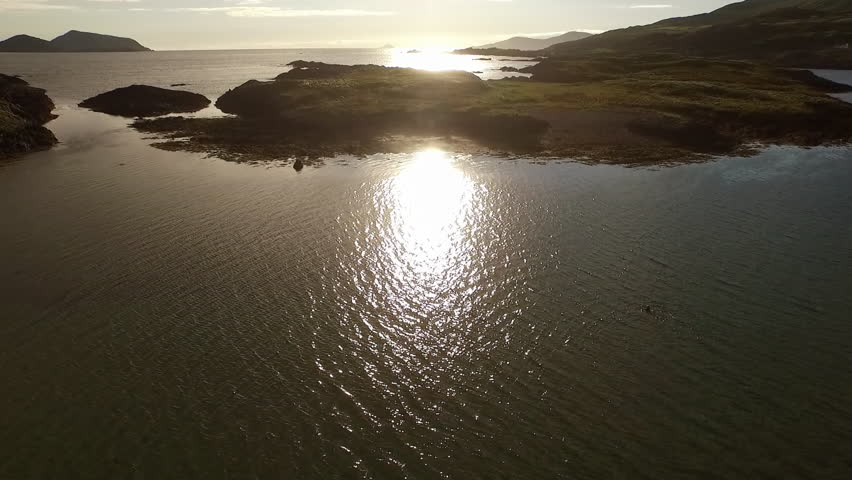 Ireland coast, lowpass flight drone towards the sea towards the sun | Shutterstock HD Video #1008382357