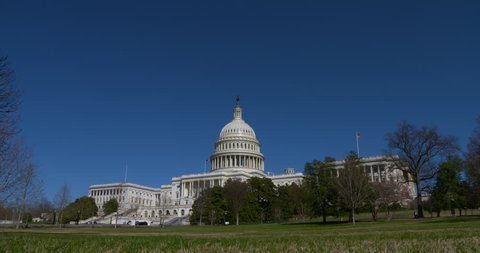 Very wide of the entire US Capitol Building with blue sky, late winter. 4K