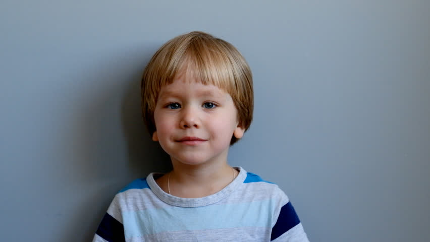 Cute boy three years old looking at camera and smiling #1008434857
