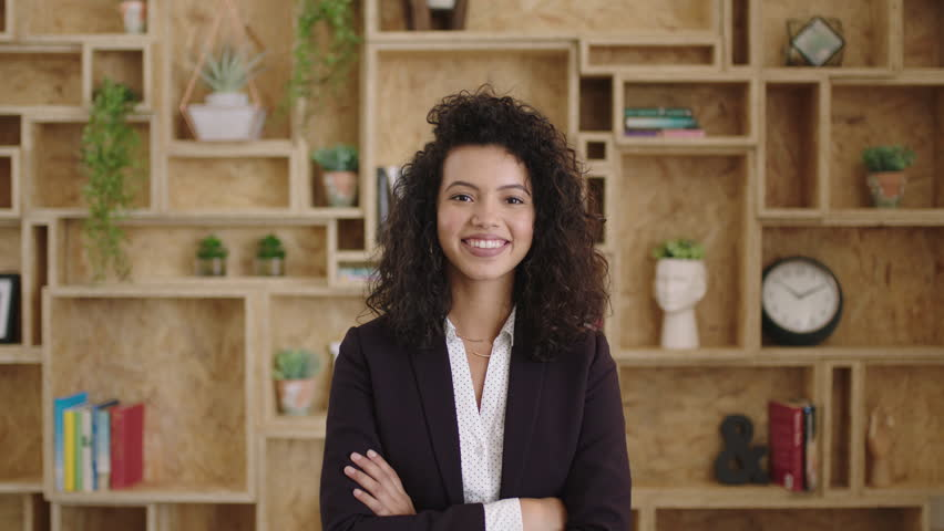 Portrait of beautiful elegant hispanic business woman smiling arms crossed happy feeling confident successful motivated corporate executive ambitious determined | Shutterstock HD Video #1008478027