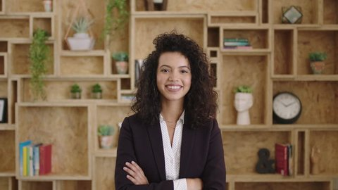 portrait of beautiful elegant hispanic business woman smiling arms crossed happy feeling confident successful motivated corporate executive ambitious determined