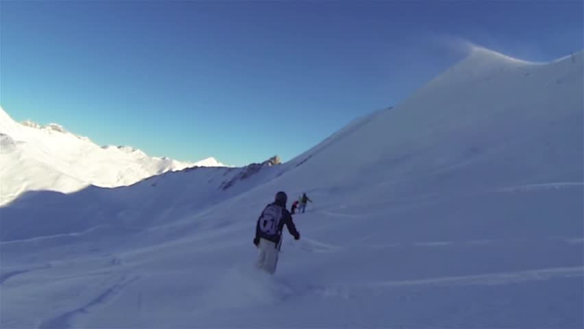 Snowboarder in powder snow with white mountain scenery in backbround #1008488497