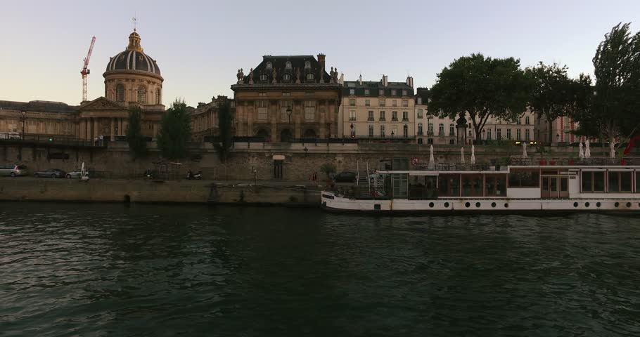 Tour boat Seine river at sunset Pont des Arts and Institut de France , Paris, France.The Institut de France is a French learned society,4K, 2160P, 4096x2160. | Shutterstock HD Video #1008602137