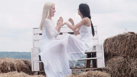 Lesbian Couple Together Outdoors Concept. LGBT Lesbian Couple Moments Happiness Concept. Young sensual lesbian couple.