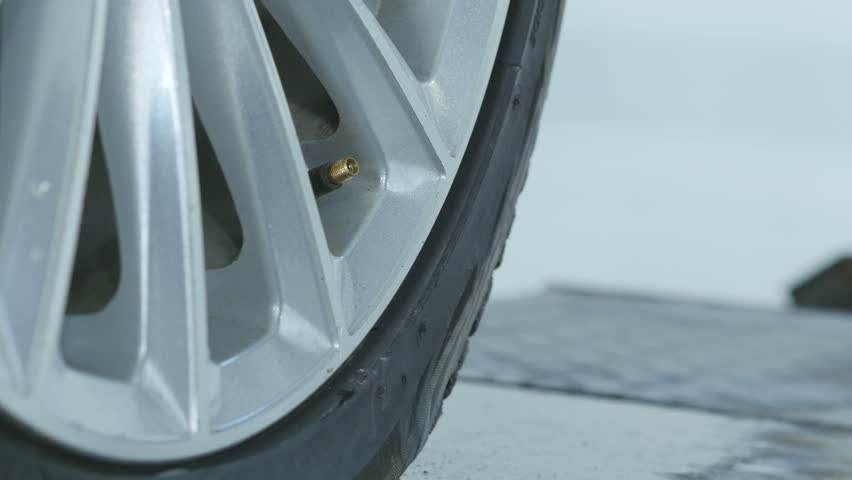Filling air into car tire, vehicle auto maintenance | Shutterstock HD Video #1008623827
