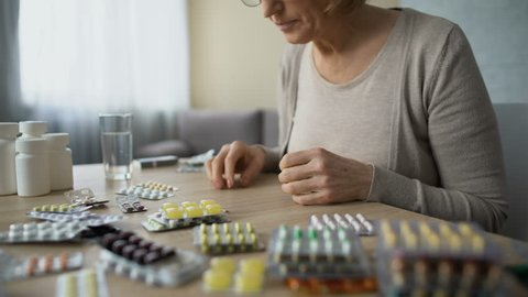 Obsessed with health care lady drinking pills with water, medicine overdose