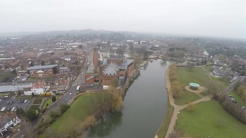 Stradford Upon Avon aerial views. River side and Shakespeare Theater, moving forward movement.