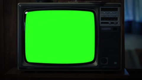 """Old 80s Television Green Screen. Night Watch. Zoom Out. You can replace green screen with the footage or picture you want with """"Keying"""" effect in AE  (check out tutorials on YouTube)."""