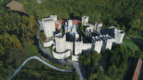 Aerial view of Manasija monastery protected by fortified walls in mountains in Serbia