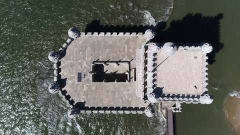 Aerial top down view of belem Tower in Portuguese Torre de Belem or Tower of St Vincent fortified tower located in Santa Maria de Belem in Lisbon Portugal and is UNESCO World Heritage Site 4k quality