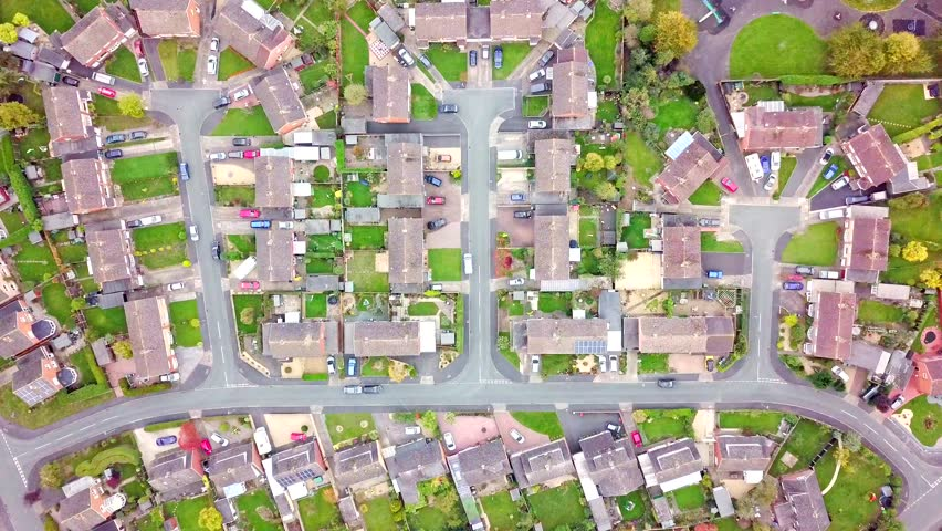 Aerial view of traditional housing estate in England. Looking straight down with a satellite image style, the houses look like a miniature village