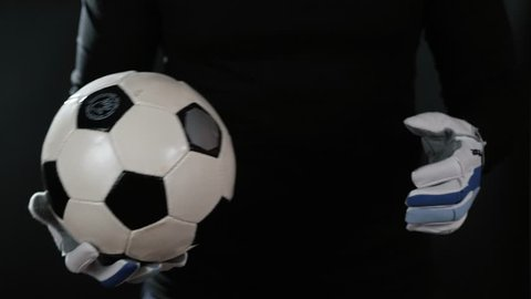 close up goalkeeper holding soccer ball in the stadium studio football player hands professional