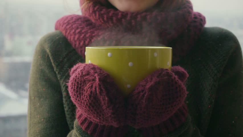 Woman Drinks Hot Tea or Coffee From yellow Cup on Winter Morning | Shutterstock HD Video #1008793367