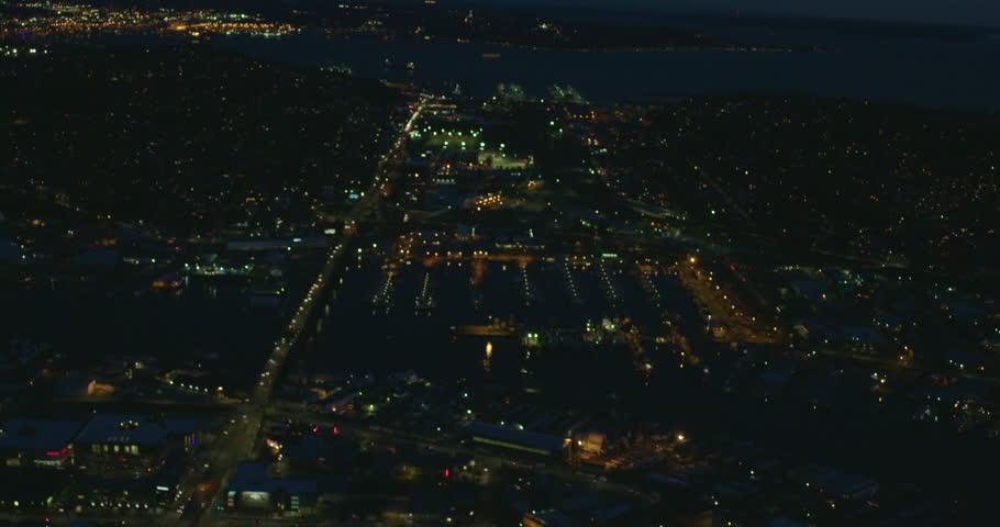 Ballard Bridge Harbor Lake Washington Ship Canal Helicopter View Aerial Looking Towards City of Seattle Downtown Elliott Bay Dusk Night Lighting Traffic Driving