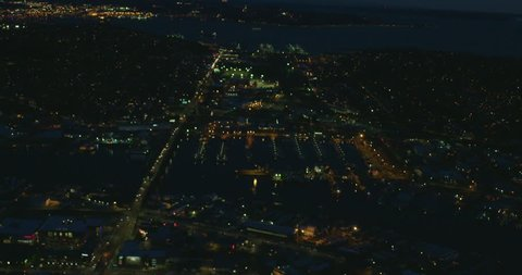 Ballard Bridge Harbor Lake Washington Ship Canal Helicopter View Aerial Looking Towards City of Seattle Downtown Elliott Bay Dusk Night Lighting Traffic Driving