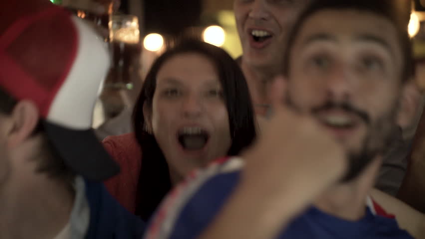 Football fans having fun while watching televised match at sports bar | Shutterstock HD Video #1008892367