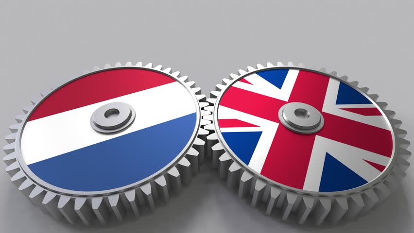 Flags of the Netherlands and The United Kingdom on meshing gears. International cooperation conceptual animation