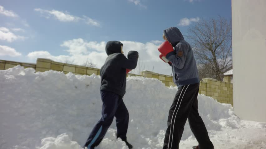 Sports children, training in boxing. Special boxing exercises in the winter. | Shutterstock HD Video #1008909377