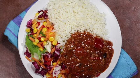 Mexican Style Spicy Chilli Con Carne With Boiled Rice And Salad