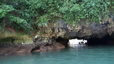 Kayaks sailing through karst cave. view of boat entering cavern and cave roof . Nature tourism in Ha Long Bay, Vietnam , Luon Cave