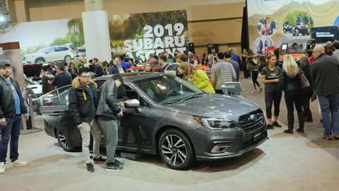 Toronto, Canada, February 20, 2018: People look at the new model of the car Subaru Legacy. At the big international exhibition of cars in Toronto