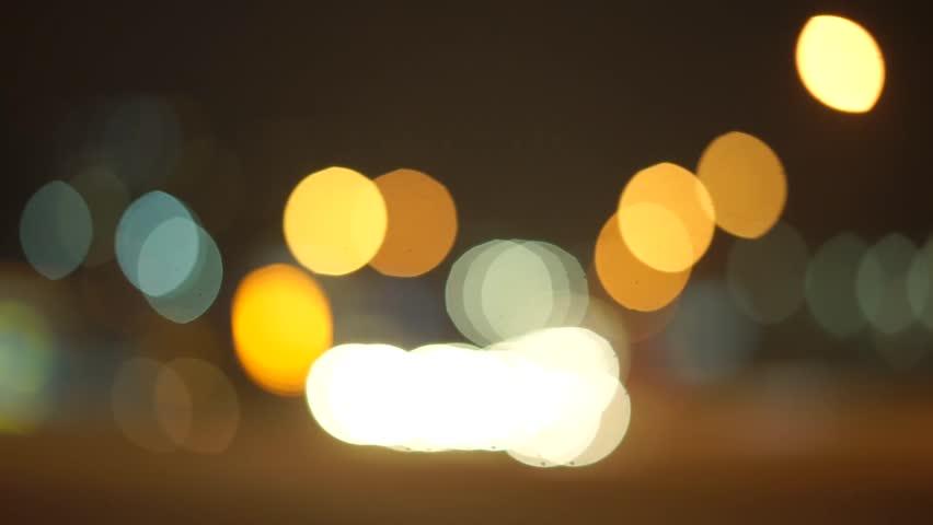 Flare night Defocused night traffic lights - Bangkok street - abstract background