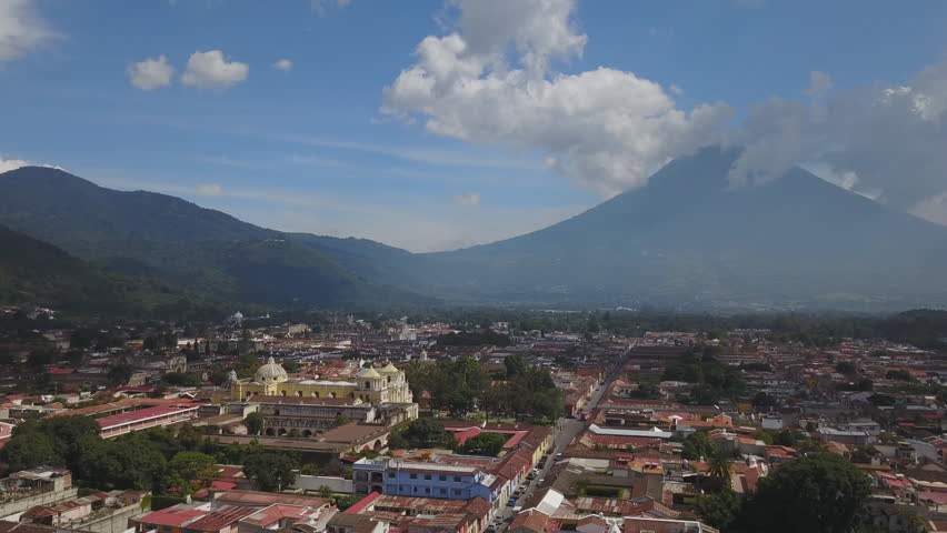 Drone aerial Guatemala Antigua city Central America Acatenango volcano of Agua. Antigua is a small city surrounded by volcanoes in southern Guatemala. It's renowned for its Spanish colonial buildings.