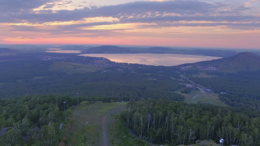 AERIAL: A colorful dawn on Lake Yakty-Kul, Bashkortostan. eautiful landscape of the valley, large lakes and a mountain chain on the horizon.