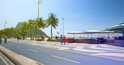 Driving along famous Copacabana  Beach mosaic walkway with palms in Rio de Janeiro, Brazil. Vintage tone applied
