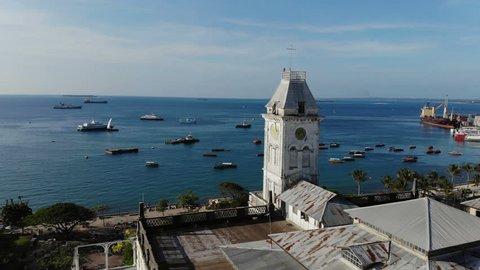 AERIAL view of the Stone Town, old part of Zanzibar City. Flight above main city of Zanzibar, Tanzania, Africa, Indian Ocean, 4k UHD