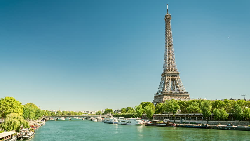 River Seine and Eiffel tower, one of the most recognisable landmarks of the world and Paris city symbol. Clear blue sky, sunny summer day. Timelapse video. | Shutterstock HD Video #1009029797