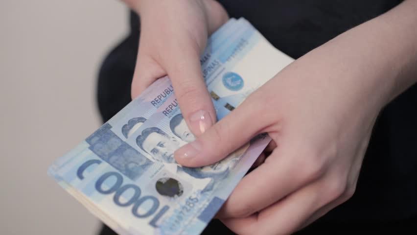 Philippine Money Coins And Bills Closeup Rotation Stock