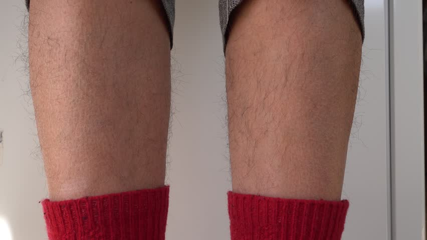 4K Female touching her hairy ankles   | Shutterstock HD Video #1009079477