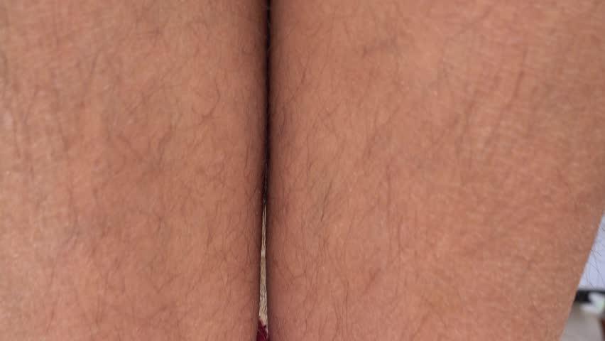4K Hiding hairy ankles under trouser legs  | Shutterstock HD Video #1009079567