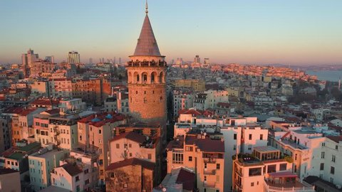 Galata tower in Istanbul, Turkie. Aerial drone shot from above, city centre, downtown. European part of the city. Sunny day, sunset.