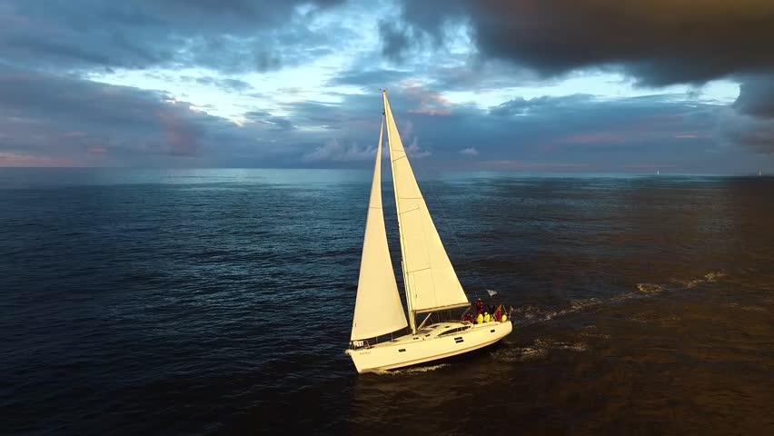 Sailboat sailing in beautiful light.    Shutterstock HD Video #1009119377
