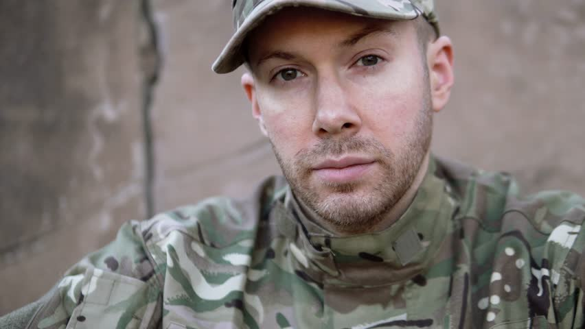 Portrait Of Sad, Tired Young Army Soldier Facing Reality Of Duty. Part Of A 4K Collection With A Variety Of Stories And Camera Angles. The Same Actor Also Back Home With Nightmare, Insomnia PTSD.