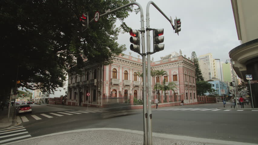 Time lapse - Crossroads in front of the historic 'Cruz-e-Souza' museum. Traffic lights and pedestrian crosswalks, busy day in the city's uptown. Florianópolis, Santa Catarina / Brazil
