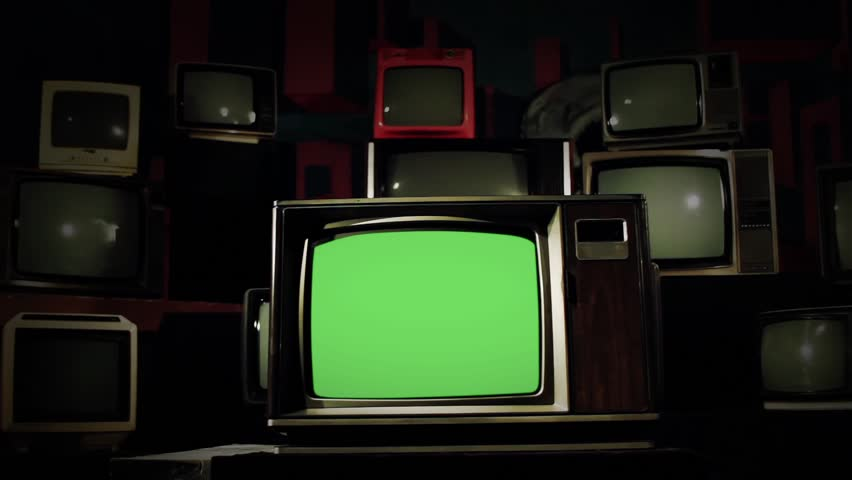 80 s Tv Green Screen in the Middle of Many Tvs. Neutral Tone. Dolly Shot.    Shutterstock HD Video #1009160567